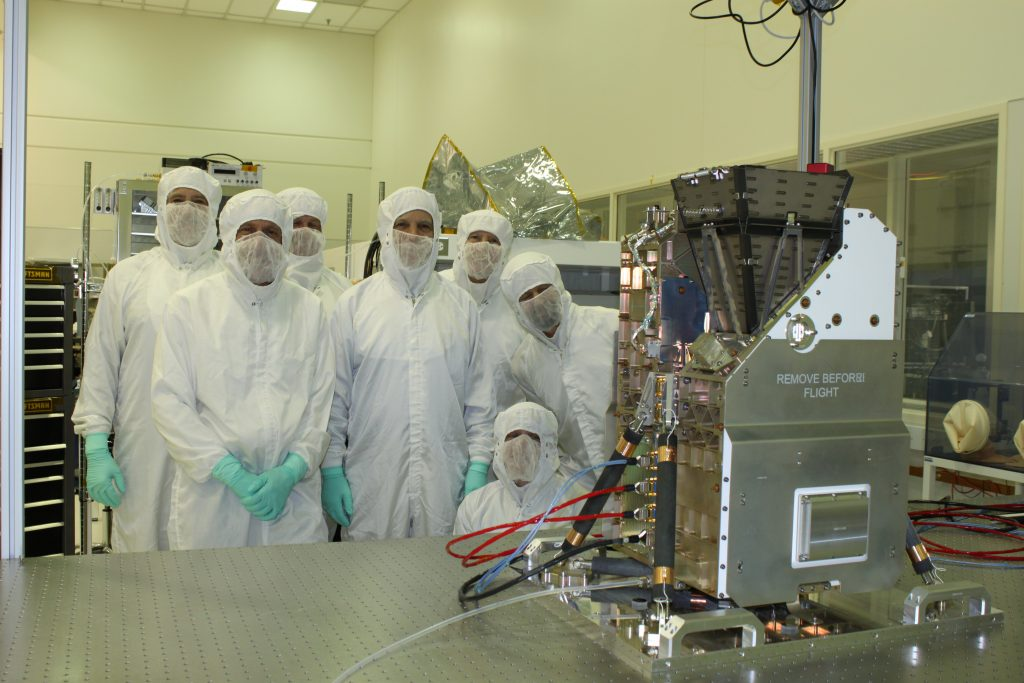 Members of the GOLD science team gather with the instrument in a LASP clean room on December 1, 2016, just after the instrument went through its pre-ship review ahead of shipment to Airbus Defence and Space in Toulouse, France. (Courtesy LASP)